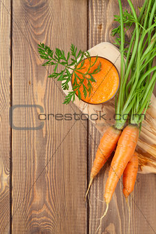 Fresh carrot juice smoothie and roots