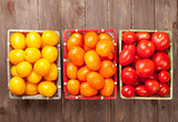 Colorful tomatoes on wooden table