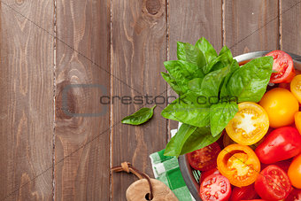 Fresh colorful tomatoes and basil