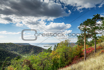 Countryside landscape with mountains and river