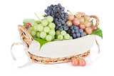 Colorful grapes in basket