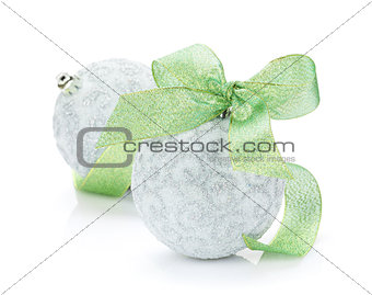 Christmas baubles and green ribbon