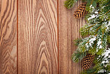 Christmas wooden background with snow fir tree
