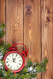 Christmas wooden background with clock, snow fir tree