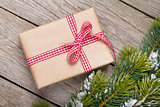 Christmas fir tree with snow and gift box