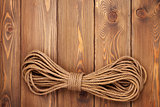 Wooden background with marine rope