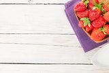 Fresh ripe strawberry in bowl and milk