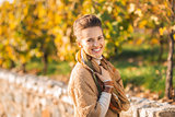 Portrait of happy elegant brunette woman in autumn outdoors