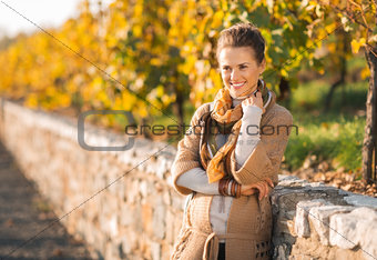 Portrait of relaxed young woman in autumn outdoors