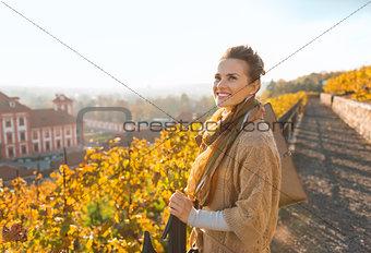 Portrait of relaxed elegant brunette woman in autumn park
