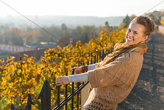 Portrait of happy elegant woman relaxing in autumn park