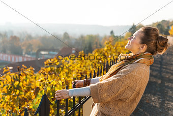 Portrait of brown-haired woman relaxing in autumn outdoors