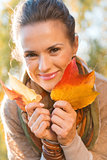 Portrait of smiling relaxed woman with autumn leafs