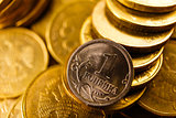 Russian coins toned in gold isolated on white