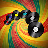 Vinyl records over multicolor vintage swirl background