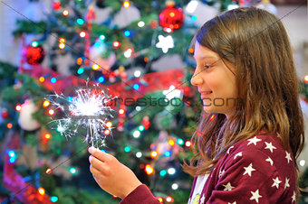 Portrait of cute girl looking at fire sparks.