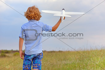 Boy with toy plane