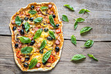 Pizza on the wooden board