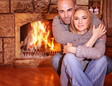 Gentle couple near fireplace