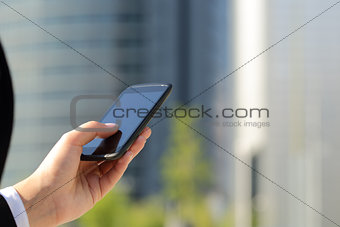 Business woman hand texting on he smart phone