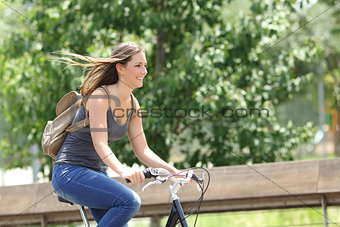 Cyclist woman riding bicycle in a park