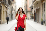 Fashion woman walking and talking on the mobile phone