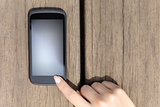 Finger pressing a blank smart phone touch screen