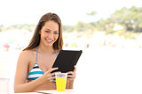 Girl reading a tablet or ebook on summer holidays