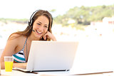 Girl taking a video conference on summer holidays