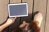 Girl using and showing a blank tablet screen