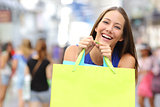 Shopper girl buying and holding a shopping bag
