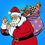 Santa Claus with gift bag okay gesture
