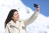 Fashion woman photographing a selfie in winter holidays