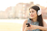 Candid girl listening music with a smartphone