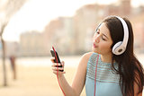 Teen girl singing and listening music from a smart phone