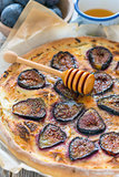 Pizza with ricotta, figs, thyme and honey.