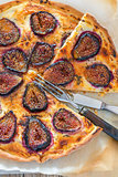 Pizza with figs and thyme. Top view.