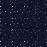 White snow falling on dark background