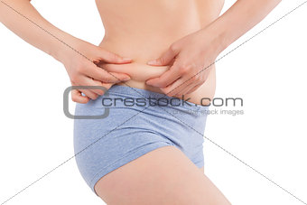 Touching body fat.