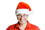 Smiling happy unshaven man with glasses and a hat Santa