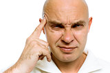 man holding his finger to his temple. Headache or problem