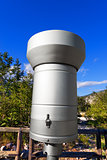 Metallic Rain Gauge in Mountain