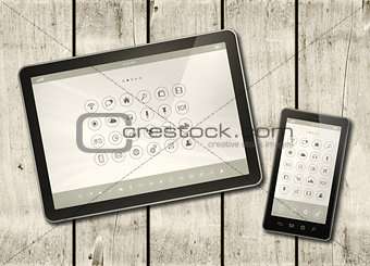 Smartphone and digital tablet PC with desktop icons on a white w