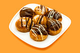 Profiteroles on orange background