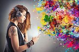 Tattoo girl listens to music