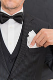 Gentleman In Black Tie Fixing Pocket Square, Vertical