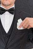 Gentleman In Black Tie Fixing Pocket Square, Vertical