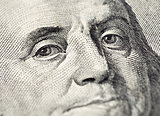 Benjamin Franklin's face on the US 100 dollar bill