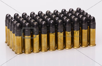 ammunition from the gun on 100 dollar bills