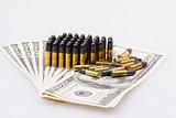 ammunition from the gun on 100 dollar bills